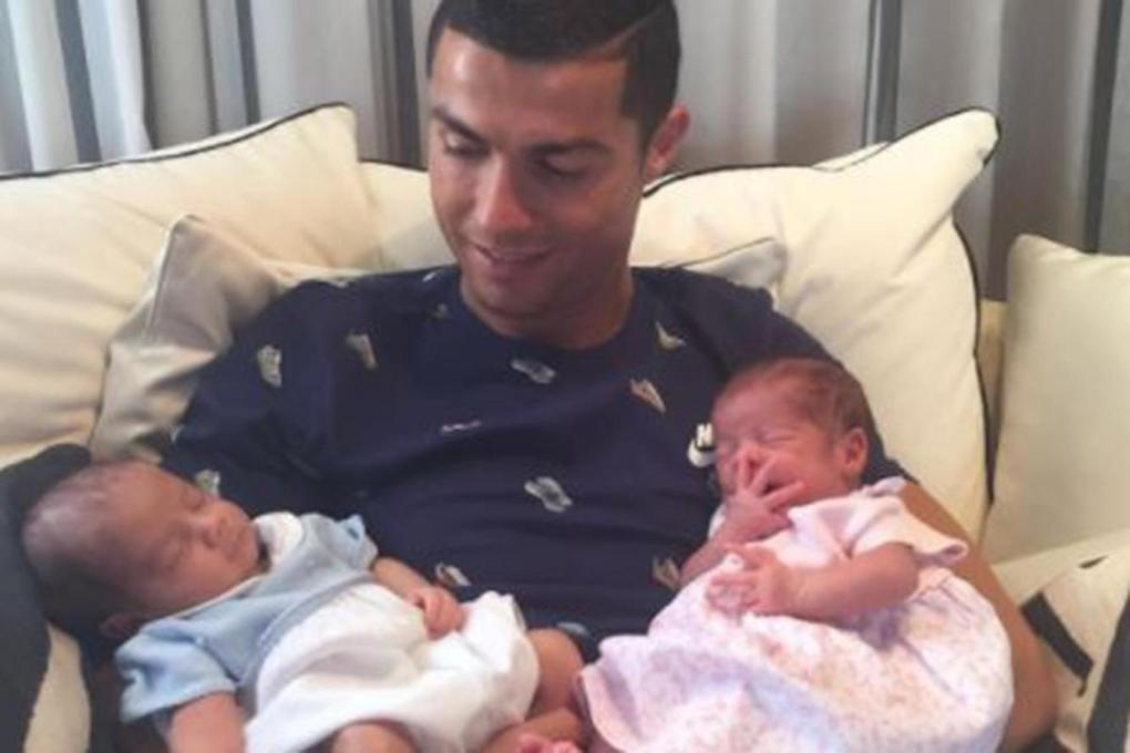 Cristiano Ronaldo posts first picture holding his baby twins after surrogate birth earlier this month