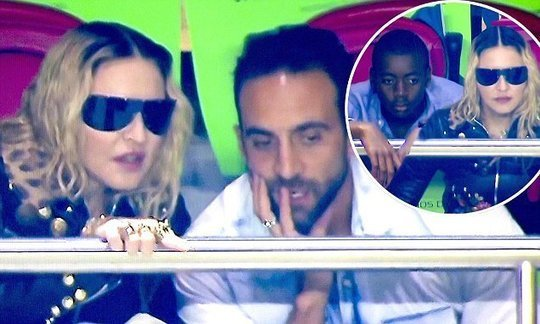 Madonna gets close to mystery male pal at Portugal match