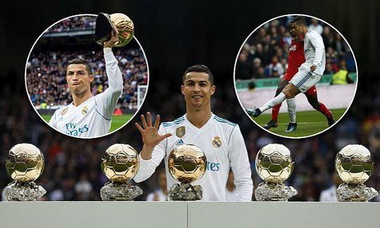 Real Madrid star Cristiano Ronaldo poses with his five Ballon d'Ors