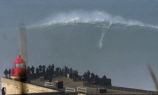 Stunning footage shows fearless surfer riding monster wave at Portuguese beach | Daily