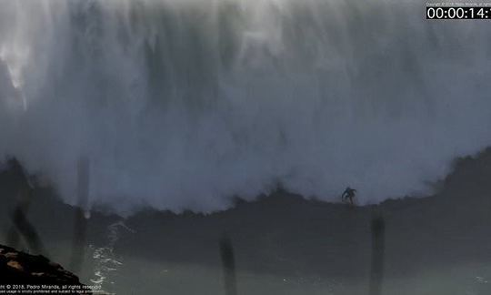 Australian surfer is wiped out as he scales 60ft monster wave off Portugal | Daily