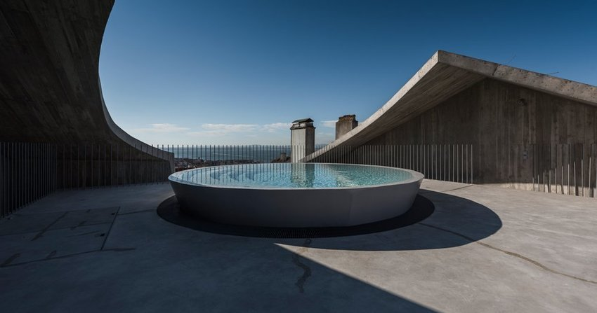 'house in estrela' by aires mateus features a parabolic concrete roof