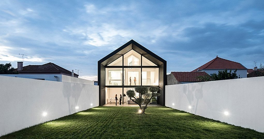 Maria Fradinho articulates the arch house with large gable roof in portugal