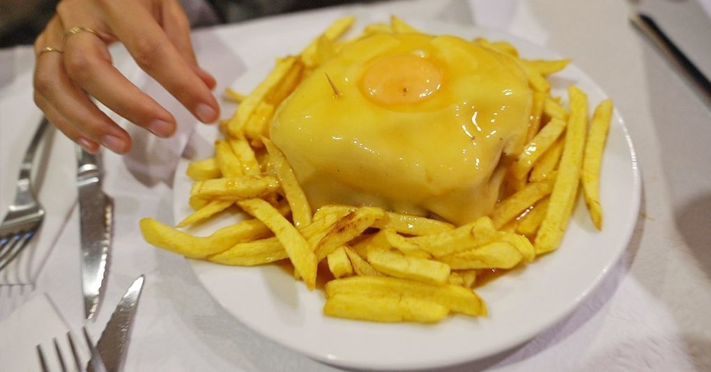 Watch: Traveling to Porto, Portugal's and Trying the Iconic Francesinha Sandwich