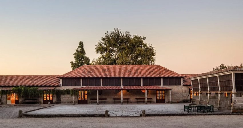 diogo aguiar studio converts disused barn into winery in northern portugal