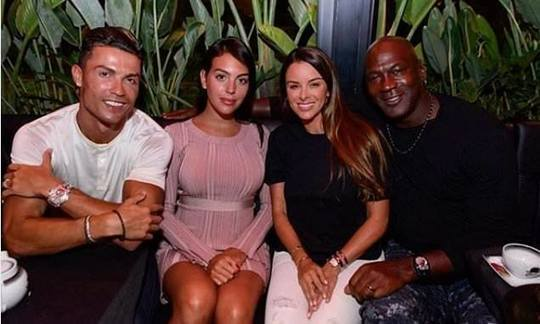 Cristiano Ronaldo poses with NBA legend Michael Jordan on holiday alongside their partners | Daily -