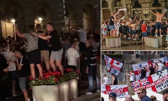 England fans chant distasteful songs as Portuguese police get ready for potential trouble   Daily -