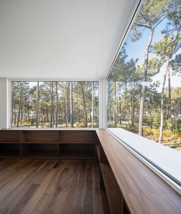 bica arquitectos finishes portuguese house with coat resembling the bark of pine trees