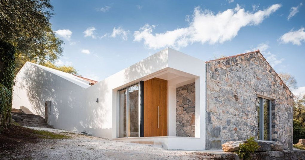 phyd arquitectura connects stone ruins to create contemporary house in portugal