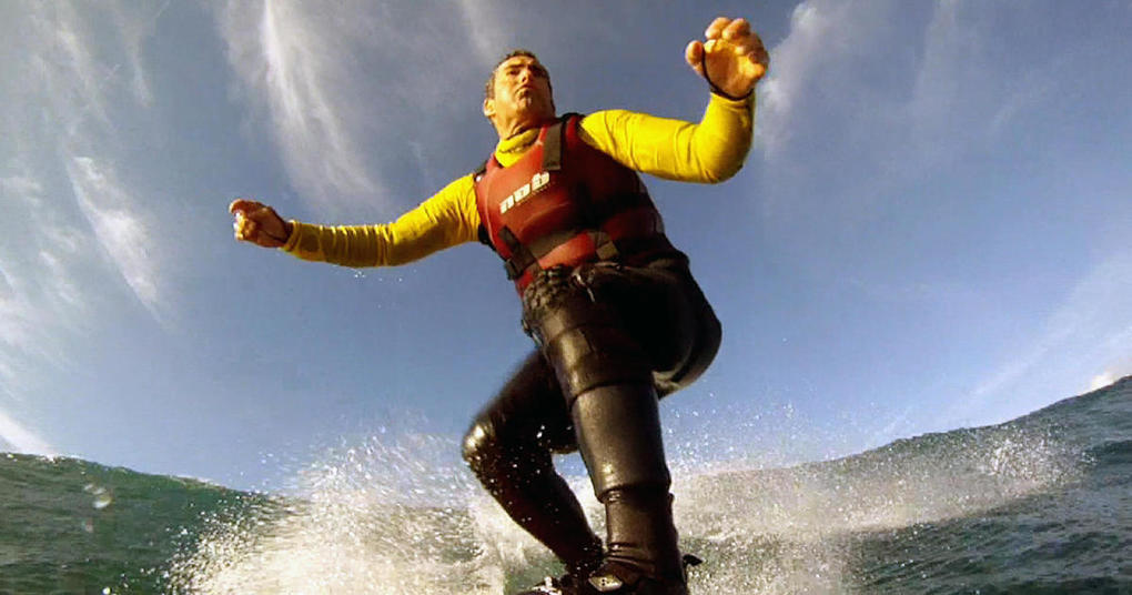 Riding the waves with Garrett McNamara in Nazaré, Portugal, an ancient town with giant waves - 60 Minutes - CBS News -