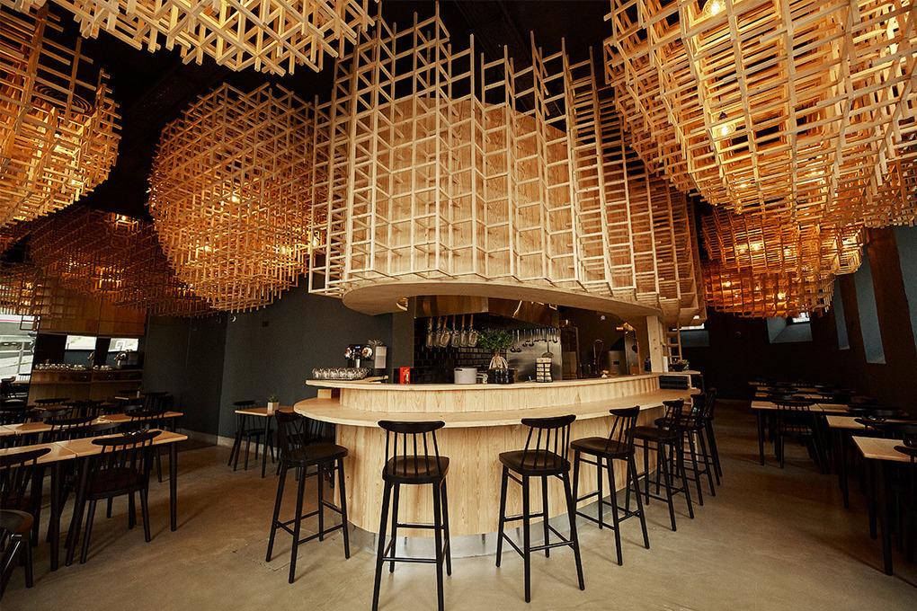 Egg-Shaped Wooden Trellises Hang from the Ceiling of Lisbon Ramen Restaurant  