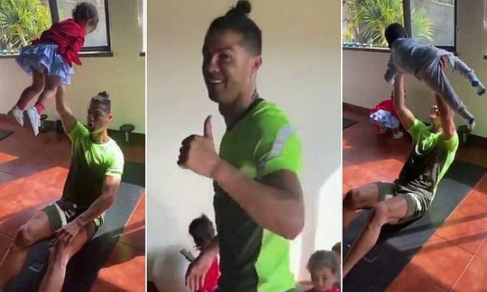 Ronaldo proves working from home is challenging as he lifts his children as he does his sit-ups | Daily -