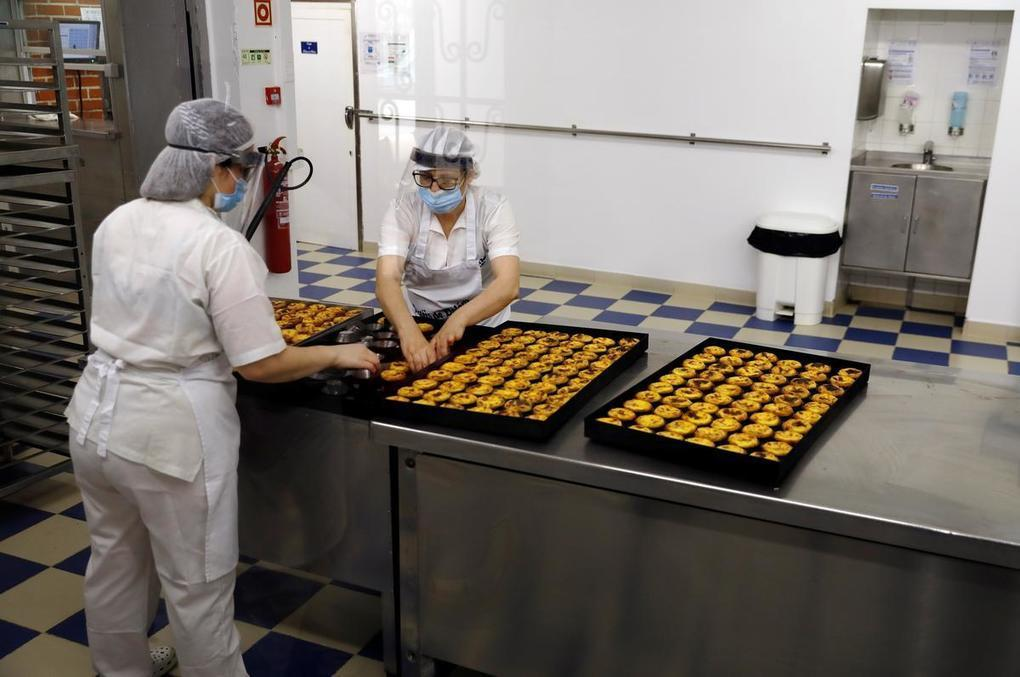 Custard tarts and classes: Portuguese enjoy some normality again - Reuters -