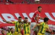 Primeira Liga: Benfica blow chance to open up lead on Porto with home draw; bus stoned after game injuring two players -