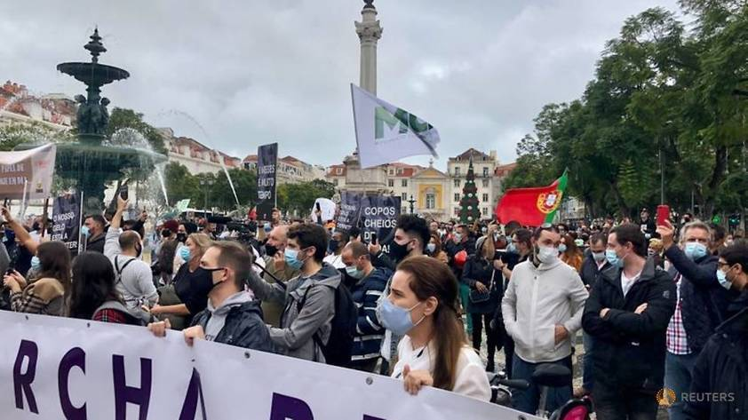 'Can't take any more': Lisbon's bar, restaurant workers protest amid COVID-19 rules -